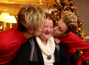 Repro Free: 25th November, 2015 Jedward, CEO of ALONE Sean Moynihan, and older persons supported by ALONE launched the ALONE Christmas Campaign 'share your presence this Christmas ' in the Westin Hotel today. Pictured is Patricia Stanley with Jedward. Picture Jason Clarke.